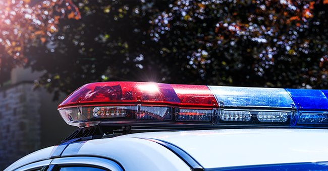 A close up of the red, white and blue lights on a police vehicle. | Photo: Shutterstock