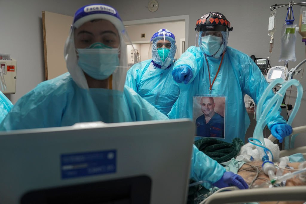 Medical staff members including Dr. Joseph Varon  examine a patient in the COVID-19 intensive care unit (ICU) at the United Memorial Medical Center on December 2, 2020 in Houston, Texas. | Photo: Getty Images