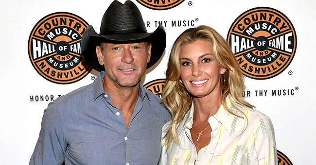 Tim McGraw & Wife Faith Hill Share a Hot Kiss on Her Birthday in This Sweet Photo