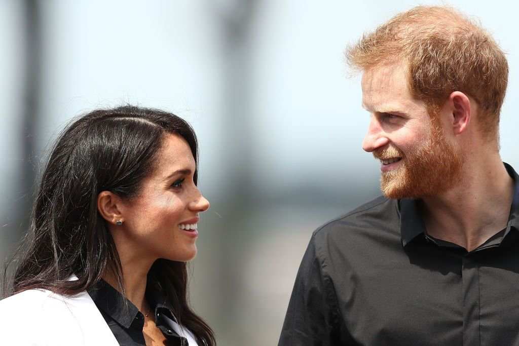 Prince Harry, Duke of Sussex and Meghan, Duchess of Sussex look at eachother during the JLR Drive Day at Cockatoo Island in Sydney, Australia | Photo: Getty Images