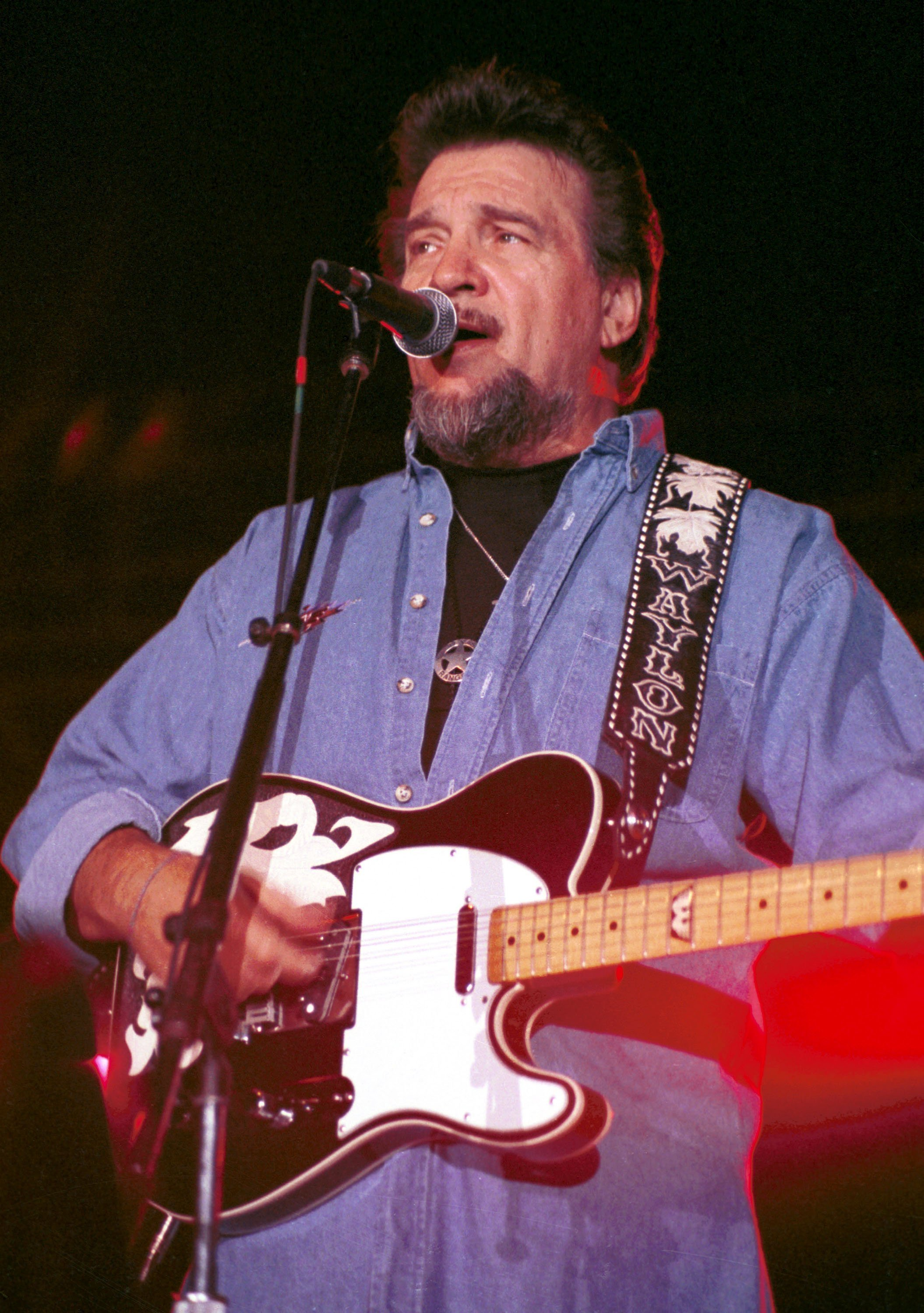 Waylon Jennings on stage - Getty Images