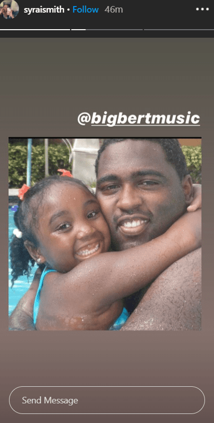 "Sy'rai Smith hugging her father Robert ""Big Bert"" Smith in the swimming pool. 
