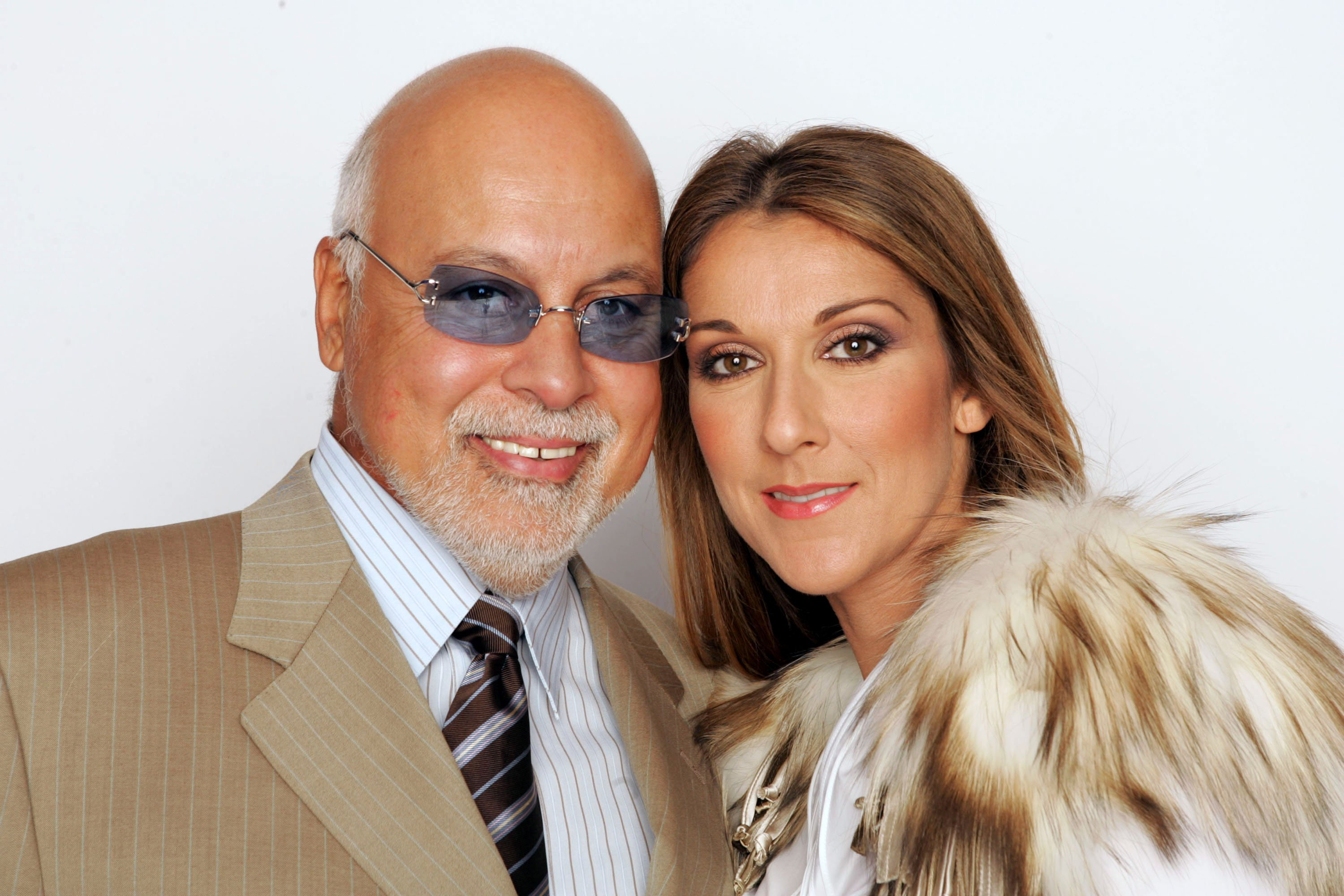 Celine Dion and her husband Rene Angelil pose for a picture backstage during the 2004 World Music Awards at the Thomas and Mack Center on September 15, 2004, in Las Vegas, Nevada. | Source: Getty Images.
