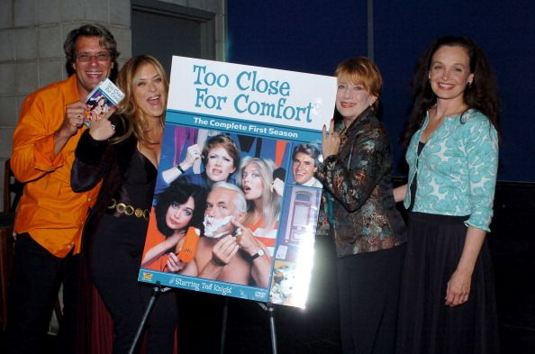 "J.M. J. Bullock, Lydia Cornell, Nancy Dussault and Deborah Van Valkenburgh pose with a ""Too Close for Comfort"" poster. 