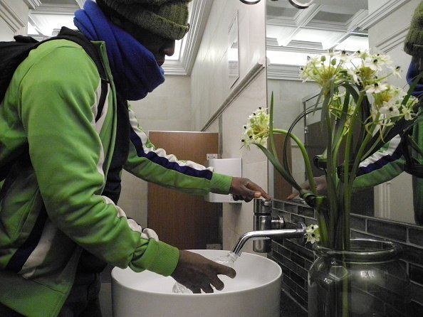 A man pictured using the tap in the restroom   Photo: Getty Images