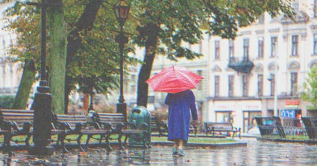 A woman walking on a rainy day.   Source: Shutterstock