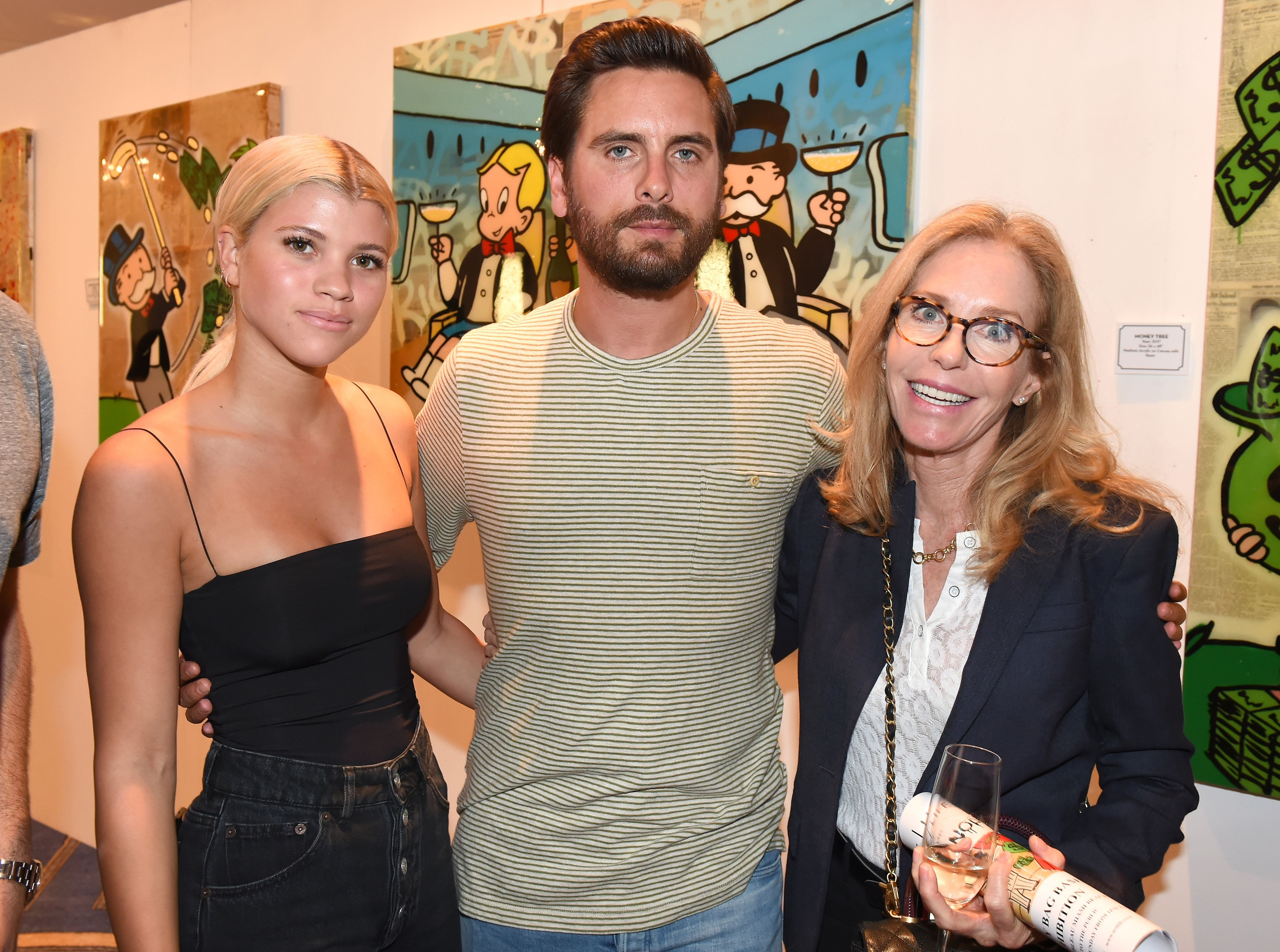 Sofia Richie, Scott Disick, and Alexandra Andon attend the opening of an art gallery at Fleur de Lis Ballroom in Miami Beach, Florida on December 7, 2017 | Photo: Getty Images