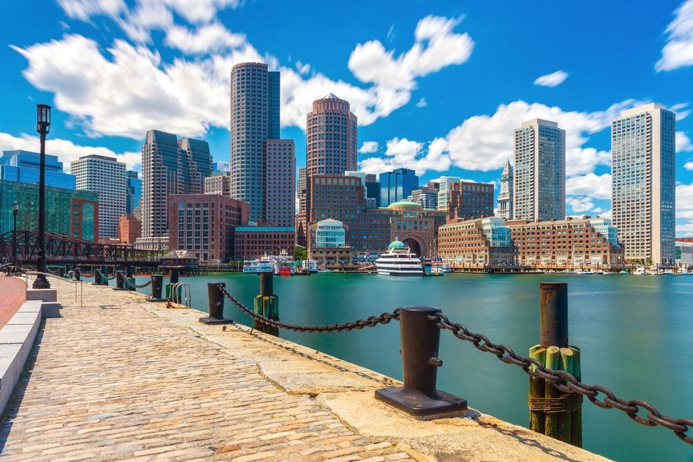 Boston skyline on a  summer day, view from harbor on downtown, Massachusetts.   Source: Shutterstock