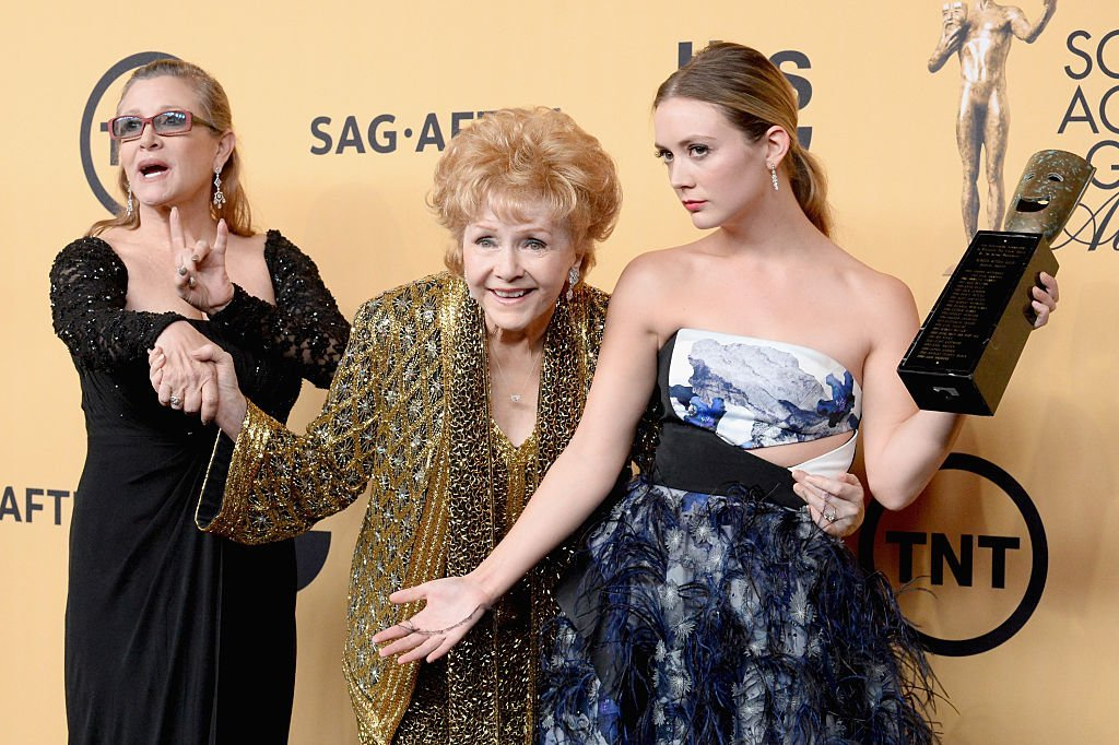 Debbie Reynolds and Carrie Fisher, pose with Billie Lourd at the 21st Annual Screen Actors Guild Awards  in 2015 in Los Angeles. | Source: Getty Images (Photo by Jeff Kravitz/FilmMagic)