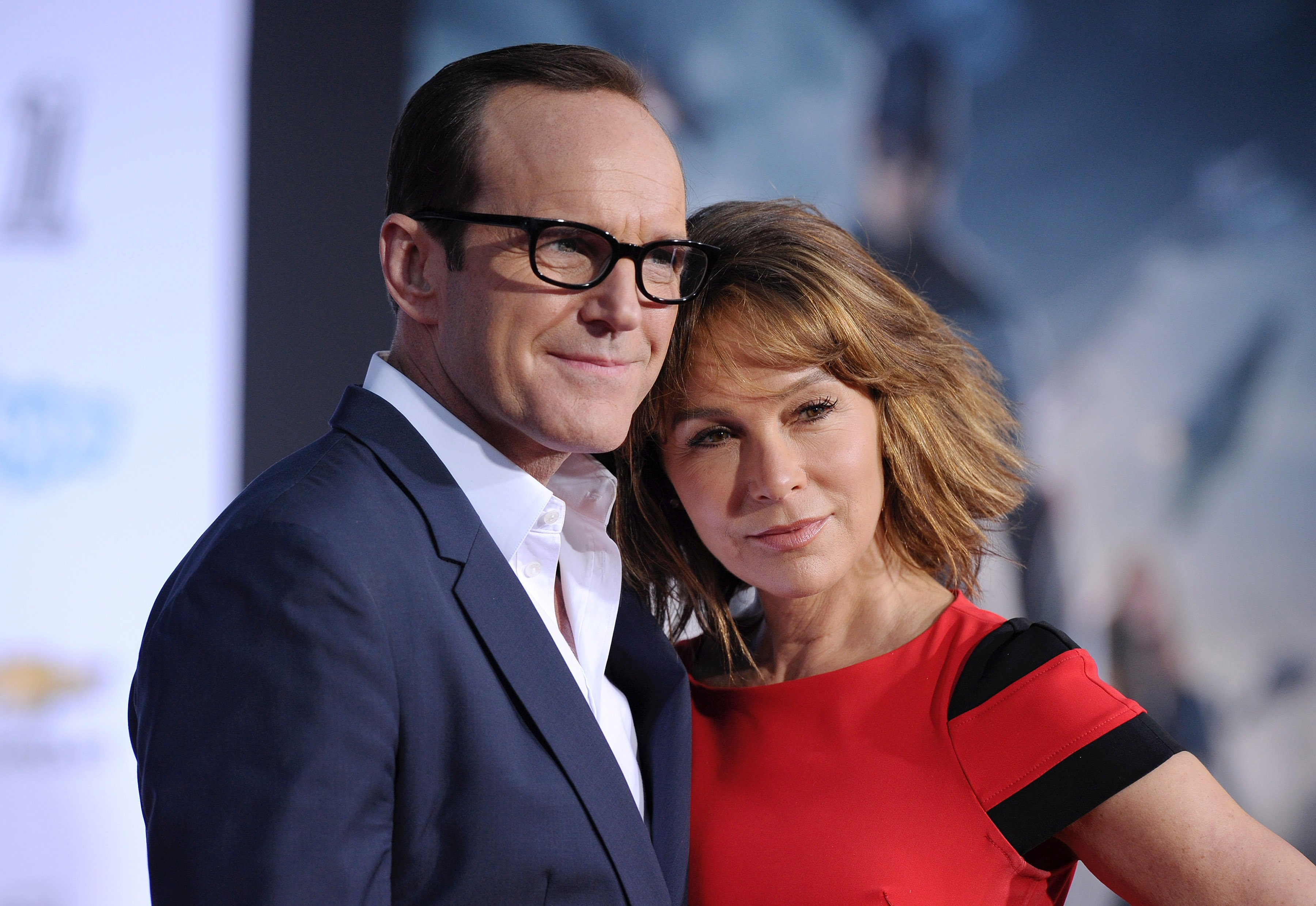 "Clark Gregg and Jennifer Grey arrive at the Los Angeles premiere of ""Captain America: The Winter Soldier"" on March 13, 2014, in Hollywood, California. 