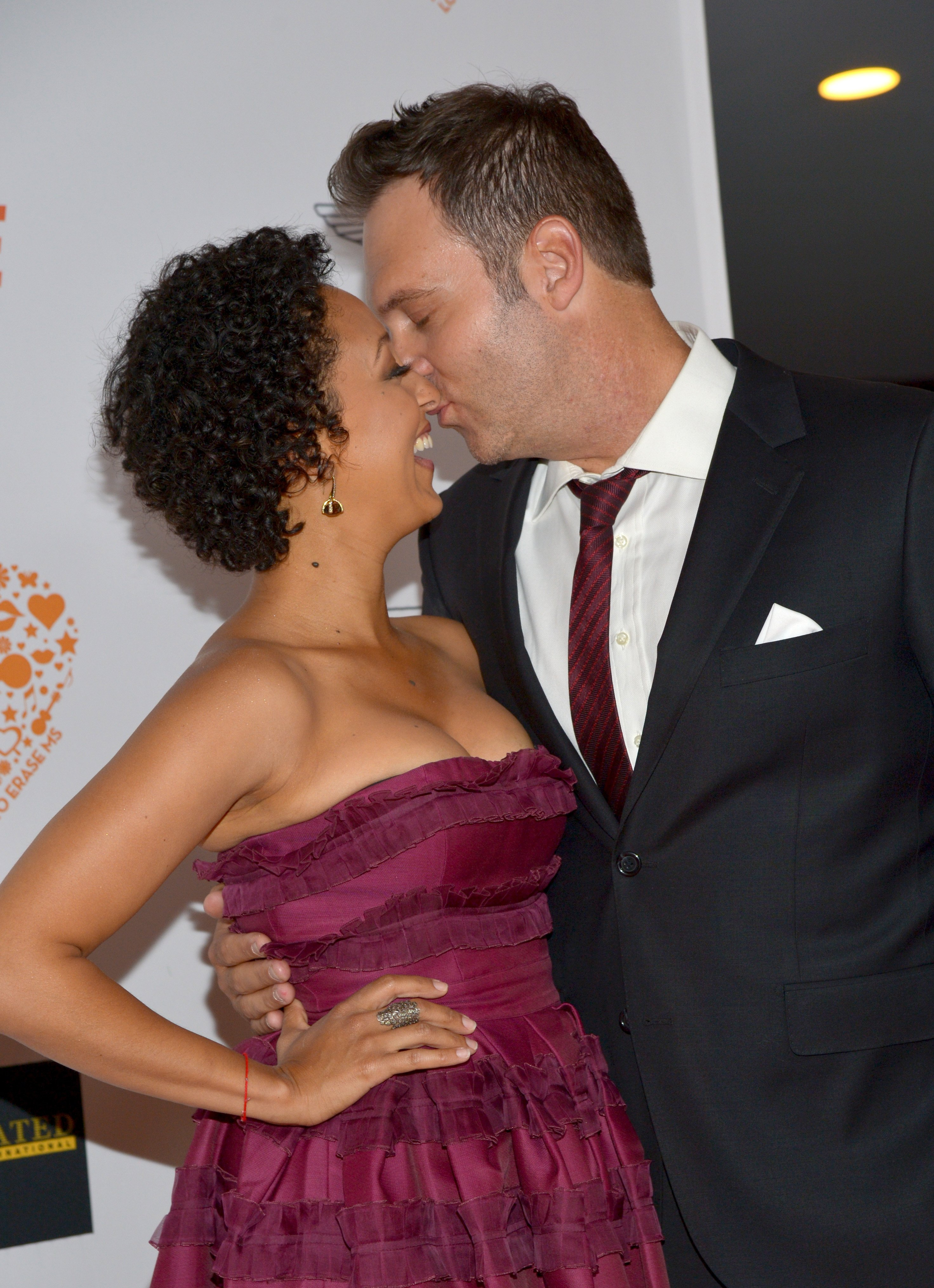 Tamera Mowry and Adam Housley share a sweet moment during the  21st annual Race to Erase MS on May 2, 2014 in Century City, California. | Source: Getty Images