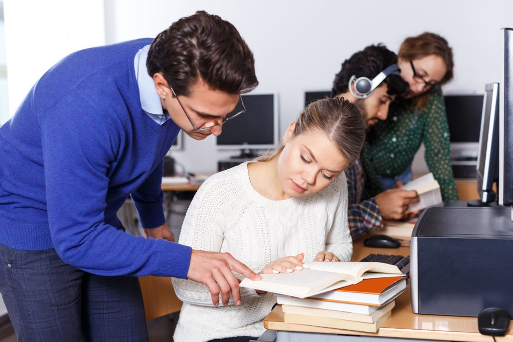 A teacher explaining the lesson to a student.   Source: Shutterstock