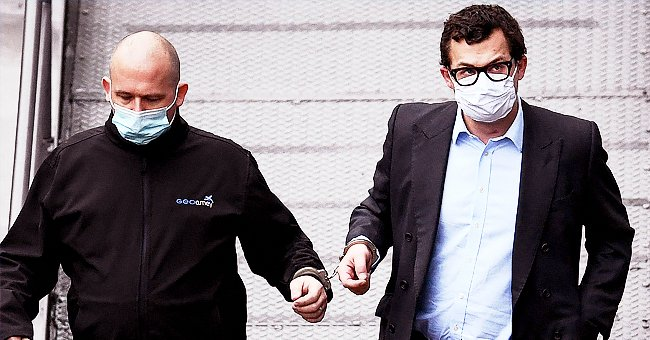Simon Bowes-Lyon, the the Earl of Strathmore, leaves Dundee Sheriff Court in handcuffs on February 23, 2021 | Photo: Getty Images