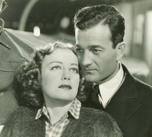 Judith Allen and Milburn Stone in Port of Missing Girls in 1938. | Source: Wikimedia Commons.
