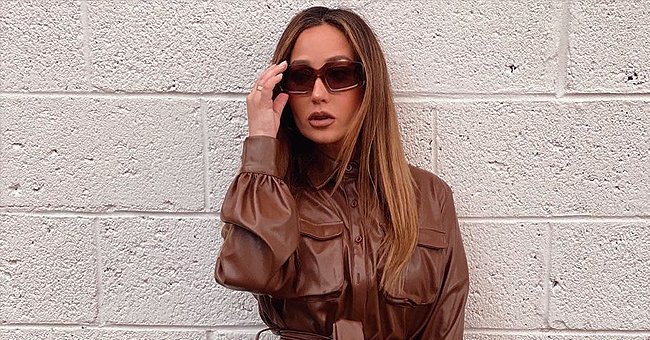 Check Out Adrienne Bailon's Impeccable Style as She Rocks a Brown Coat with Matching Boots