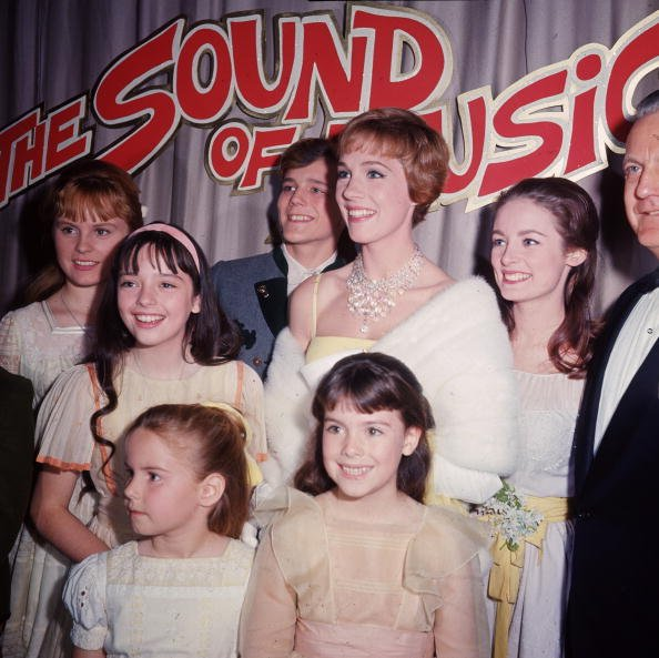 "Julie Andrews poses with other cast members of ""The Sound of Music,"" at the film's premiere in 1965 in Hollywood, California. 