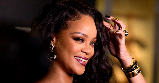 Rihanna Snuggles with Her Friend's Newborn Baby in Adorable New Photo