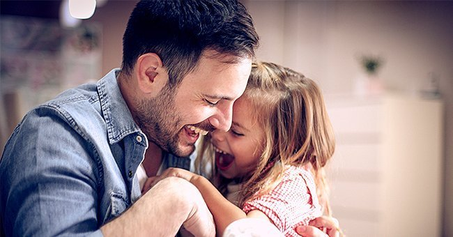 A father and his daughter laughing together.| Photo: Shutterstock.