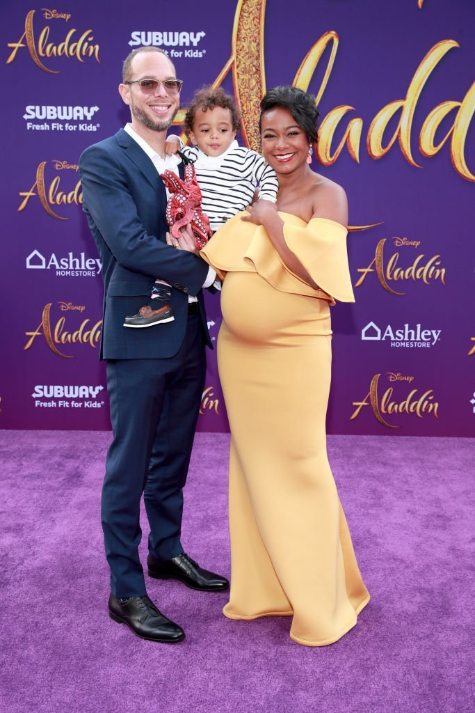 "Vaughn Rasberry, Edward Aszard Rasberry and Tatyana Ali attend the premiere of Disney's ""Aladdin"" 