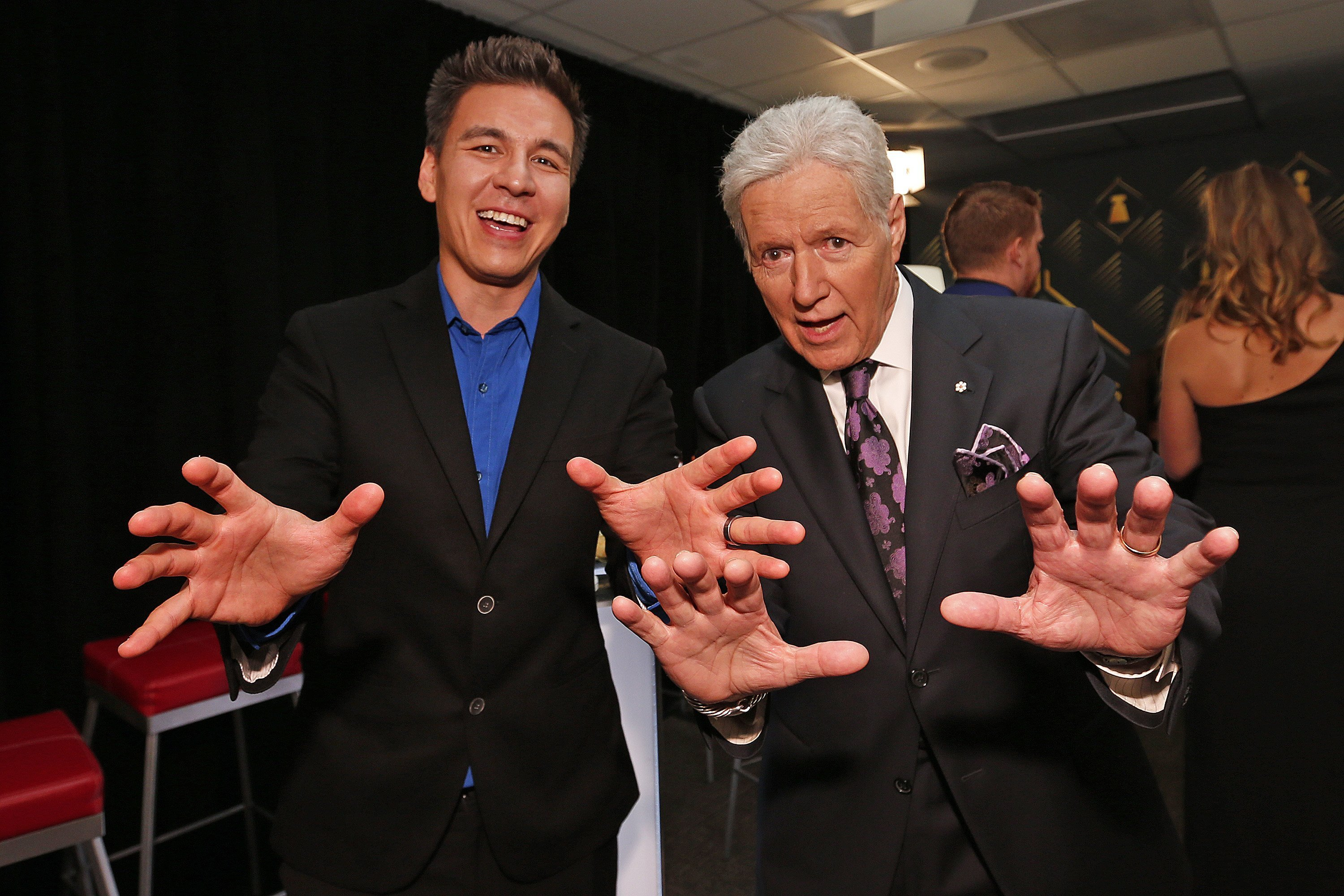 """""""Jeopardy!"""" host Alex Trebek poses with """"Jeopardy!"""" champion James Holzhauer backstage at the 2019 NHL Awards. 