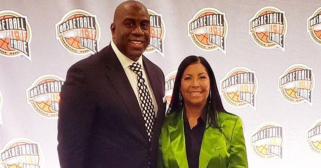 Magic Johnson's Wife Cookie Proves She Has Great Style Posing in Colored Coats during Outings with Him