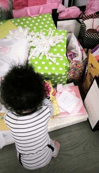 Stormi looking at her mountain of presents | Instagram stories: Kylie Jenner