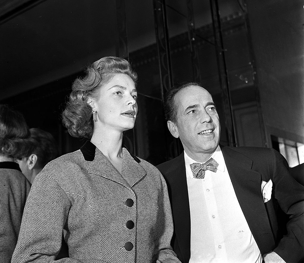 Legendary American film star Humphrey Bogart is pictured with his actress wife Lauren Bacall at a press reception at Claridges, London, England, 1951. | Source: Getty Images