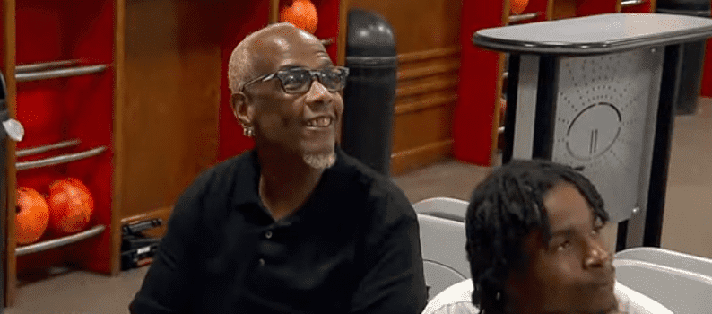 61-year-old Guy Bryant with one of the foster kids in his care | Photo: Youtube/Good Morning America