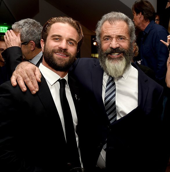 "Director Mel Gibson (R) and his son actor Milo Gibson pose at the after party for a screening of Summit Entertainment's ""Hacksaw Ridge"" at the Academy of Motion Picture Arts and Sciences on October 24, 2016, in Beverly Hills, California. 