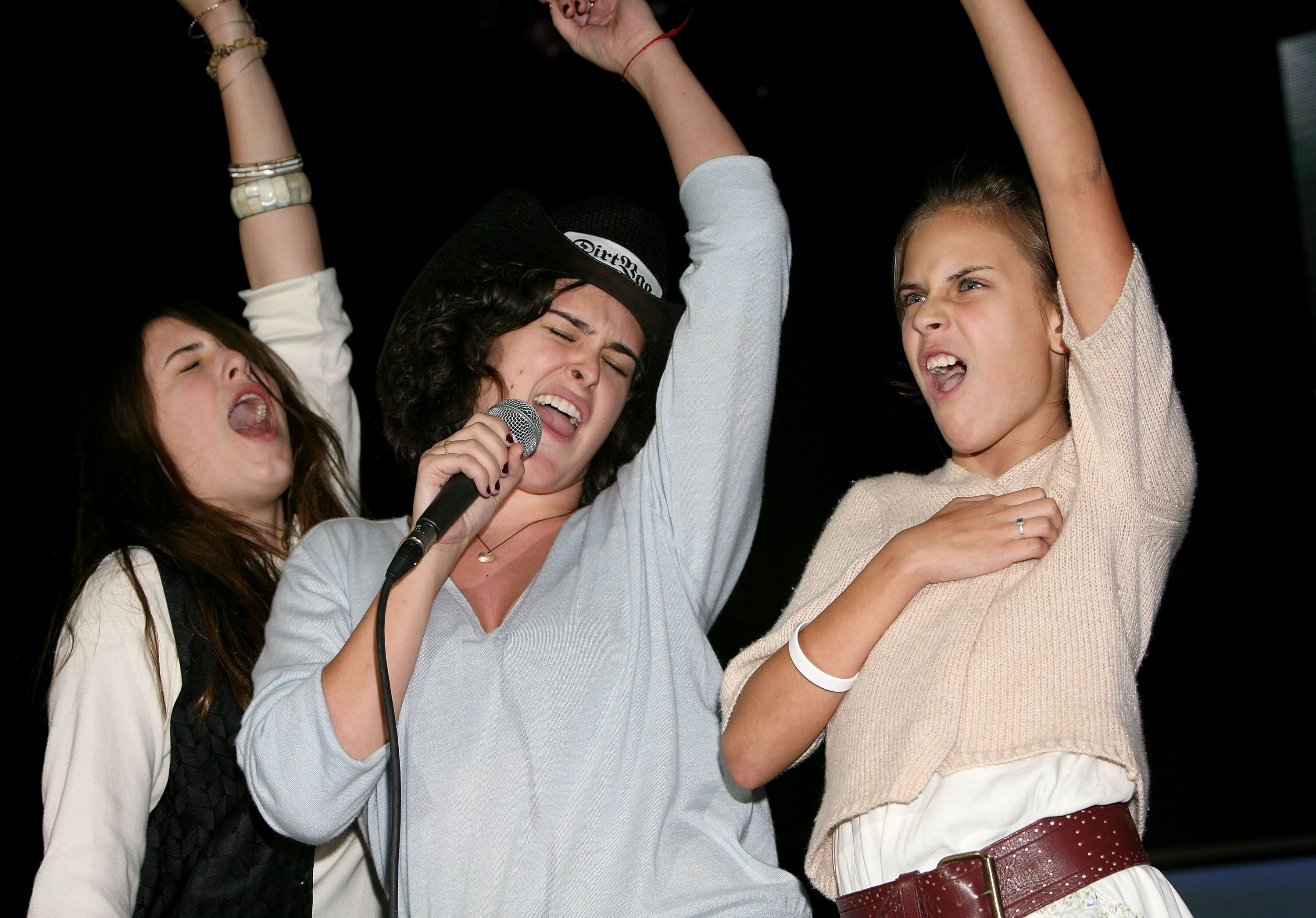 Sisters Scout Willis, Rumer Willis and Tallulah Willis perform onstage during Playstation Bandtogether, a benefit presented by Sony and the Bruce Willis Foundation held at Smashbox Studios on December 10, 2005 in Culver City, California | Photo: Getty Images