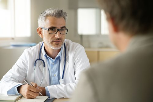 A doctor talking to his patient. | Source: Shutterstock.
