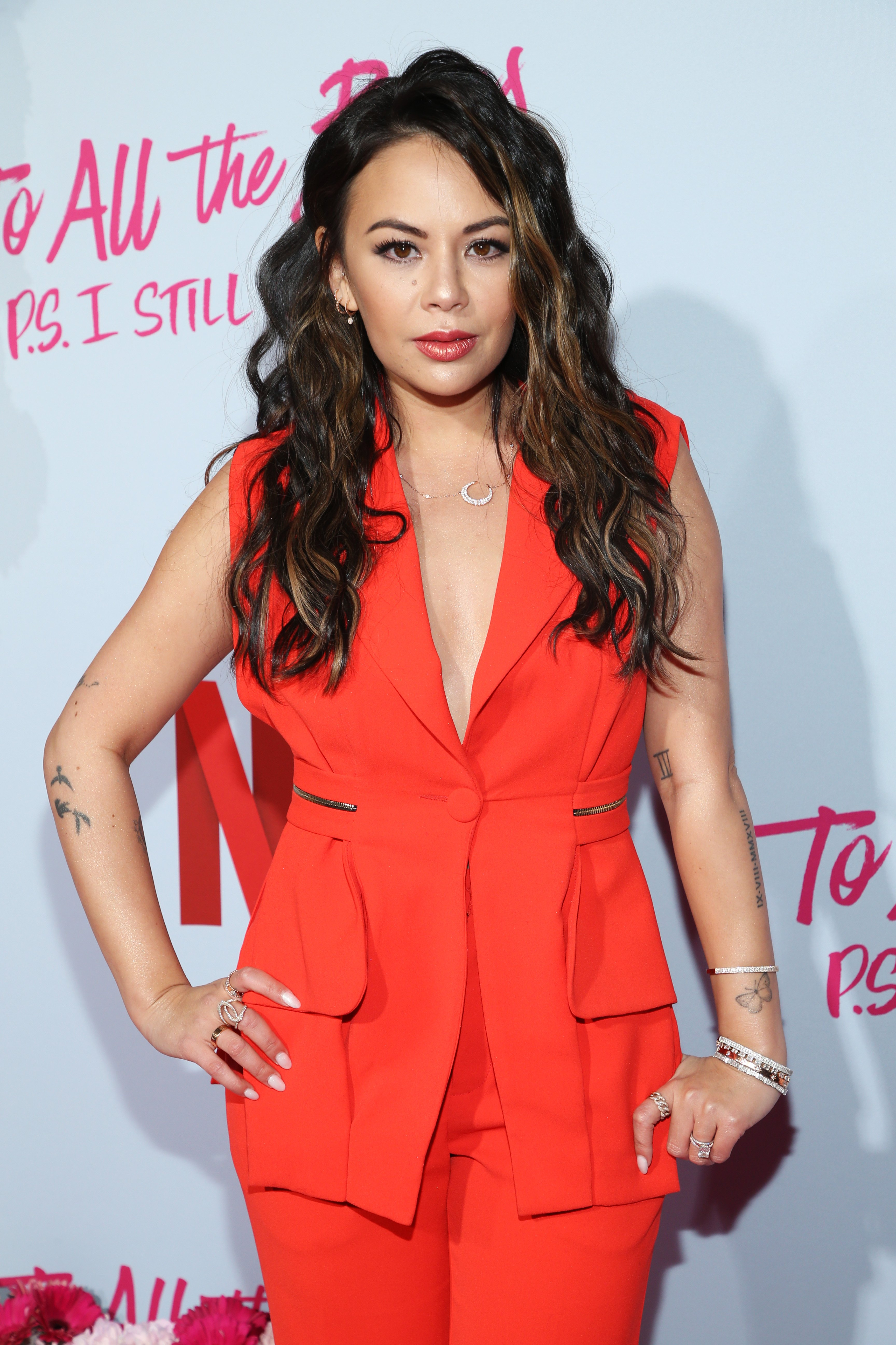 """Janel Parrish poses at the premiere of Netflix's """"To All The Boys: P.S. I Still Love You"""" at the Egyptian Theatre on February 03, 2020 in Hollywood, California. 