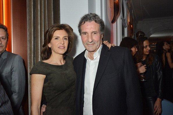 Jean Jacques Bourdin et son épouse Anne Nivat assistent à la'Neo Burlesque Party' le 20 mars 2014 à Paris   Photo : Gettyimage