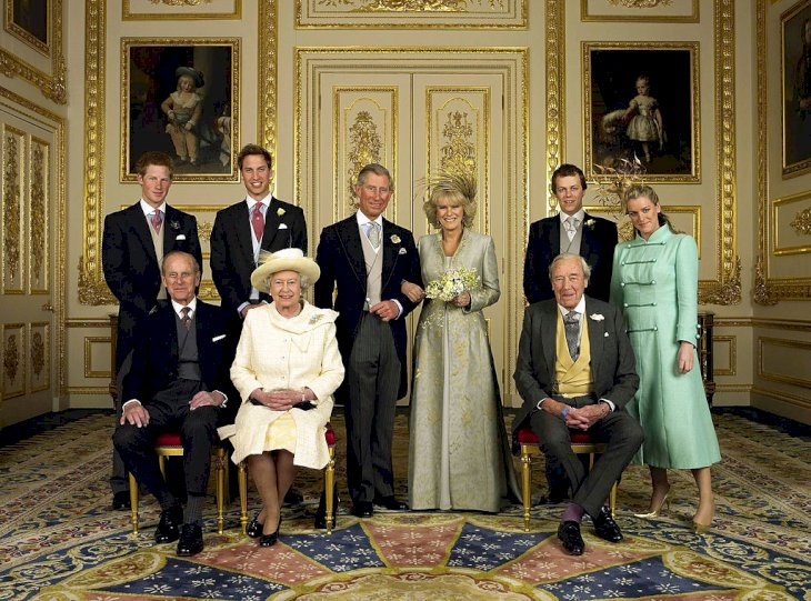 The Prince of Wales and his new bride Camilla, Duchess of Cornwall, with their families (L-R) back row Prince Harry, Prince William, Tom Parker Bowles and Laura Parker Bowles (L-R front row) Duke of Edinburgh, HM The Queen Elizabeth II and Camilla's father Major Bruce Shand, in the White Drawing Room at Windsor Castle Saturday April 9 2005, after their wedding ceremony. (Photo by Anwar Hussein Collection/ROTA/WireImage)