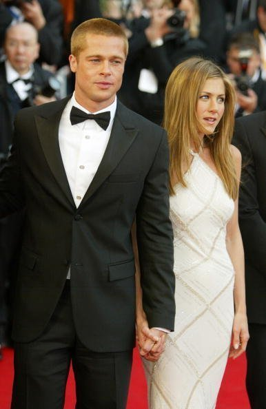 Brad Pitt and Jennifer Aniston at Le Palais de Festival on May 13, 2004 in Cannes, France. Aniston wears a dress by Versace. | Photo: Getty Images