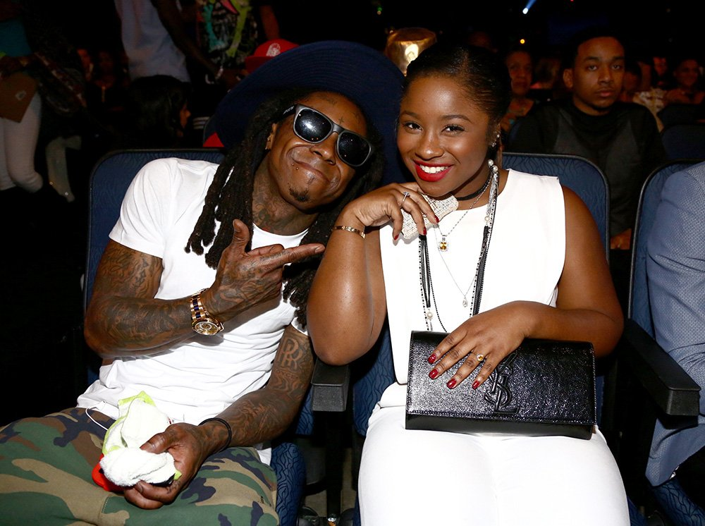 Rapper Lil Wayne (L) and Reginae Carter attend the BET AWARDS '14 at Nokia Theatre L.A. LIVE on June 29, 2014 in Los Angeles, California. I Image: Getty Images.