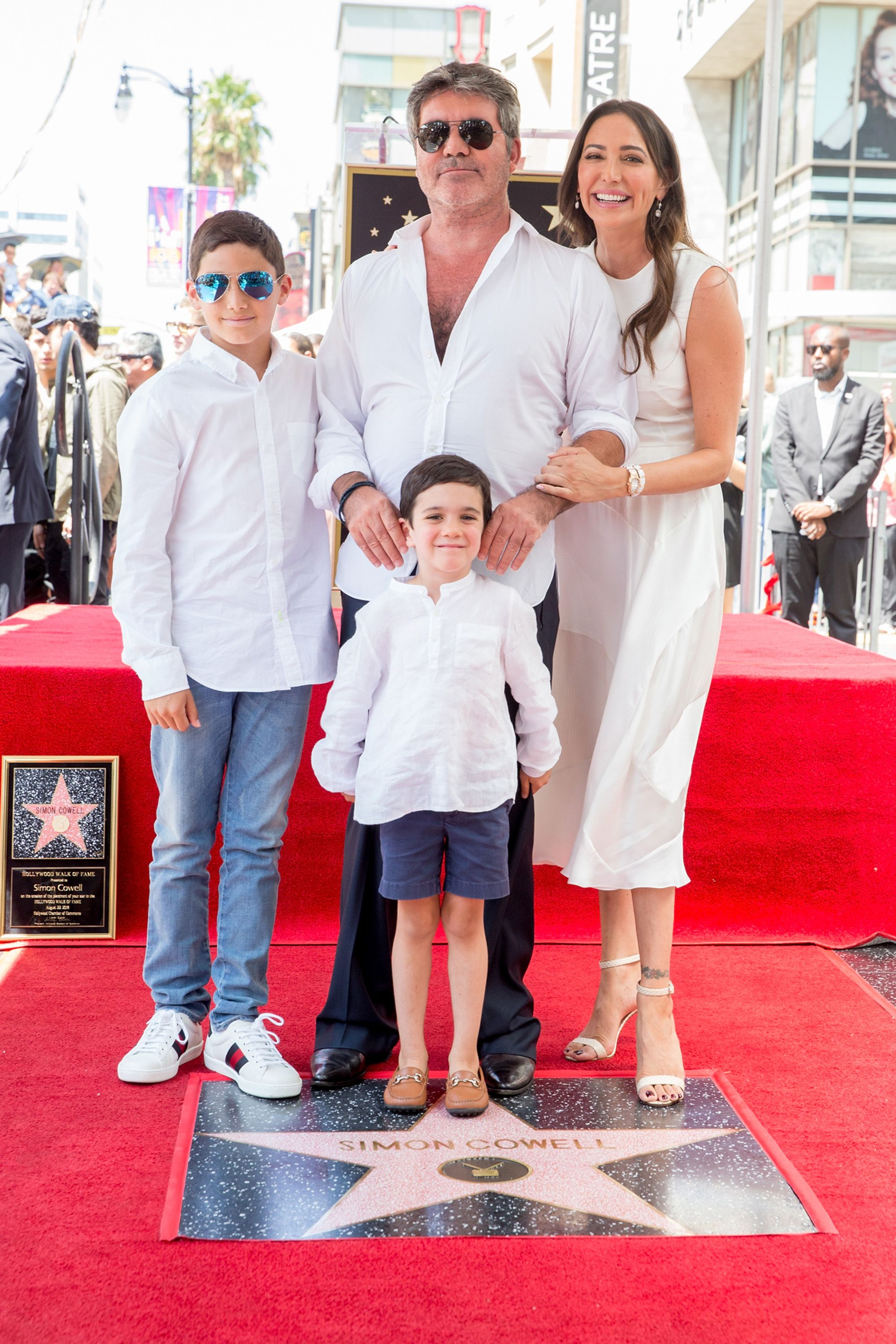 Adam Silverman, Simon Cowell, Lauren Silverman, and Eric Cowell at a ceremony honoring Cowell with a star on the Hollywood Walk of Fame on August 22, 2018, in California | Photo: Rich Fury/Getty Images