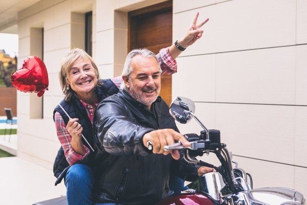 Senior couple on a bike | Source: Freepik