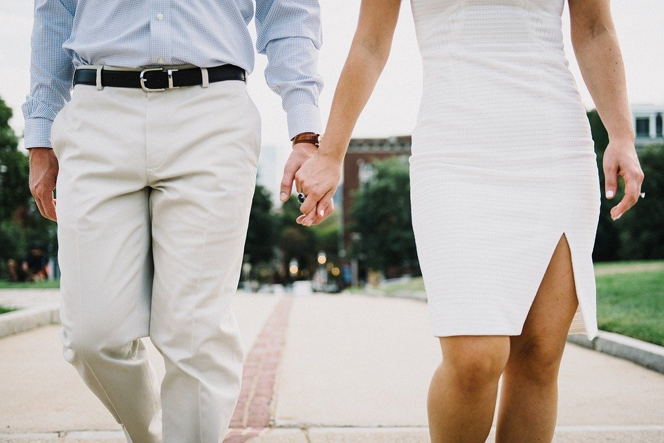 A man and his wife holding hands and walking down an isle together  | Photo: Pixabay