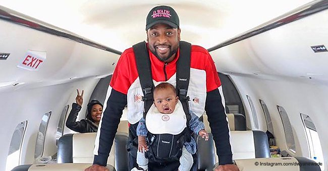 Gabby Union's Husband Steals Hearts, Holding Baby Kaavia in Carrier While Flying on Plane in Pic