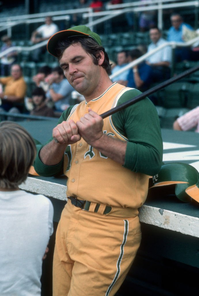 Denny McLain #31 of the Oakland Athletics talks with a young fan prior to the start of a Major League Baseball game circa 1972. McLain played for the Athletics in 1972. | Source: Getty Images