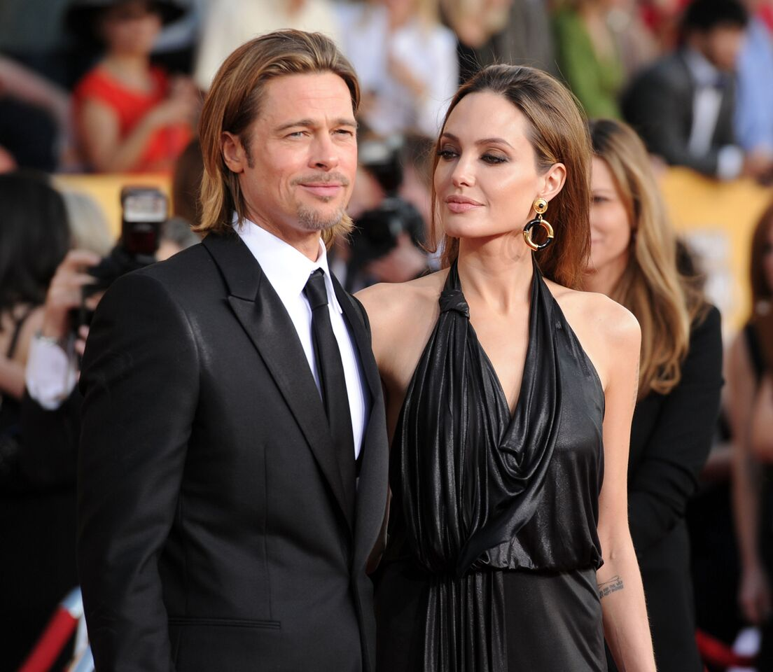 Brad Pitt and actress Angelina Jolie arrive at the 18th Annual Screen Actors Guild Awards. | Source: Getty Images