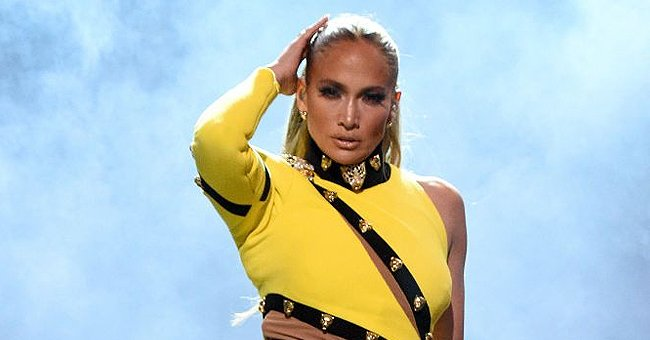 J Lo Stuns in a Cut-Out Lemon Yellow Mini Dress and Colorful Neon Bodysuit from Roberto Cavalli