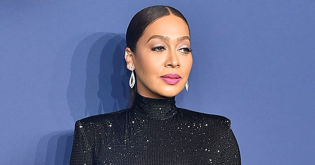 La La Anthony Looks Divine as She Shows off Her Curvaceous Body in an Orange Swimsuit