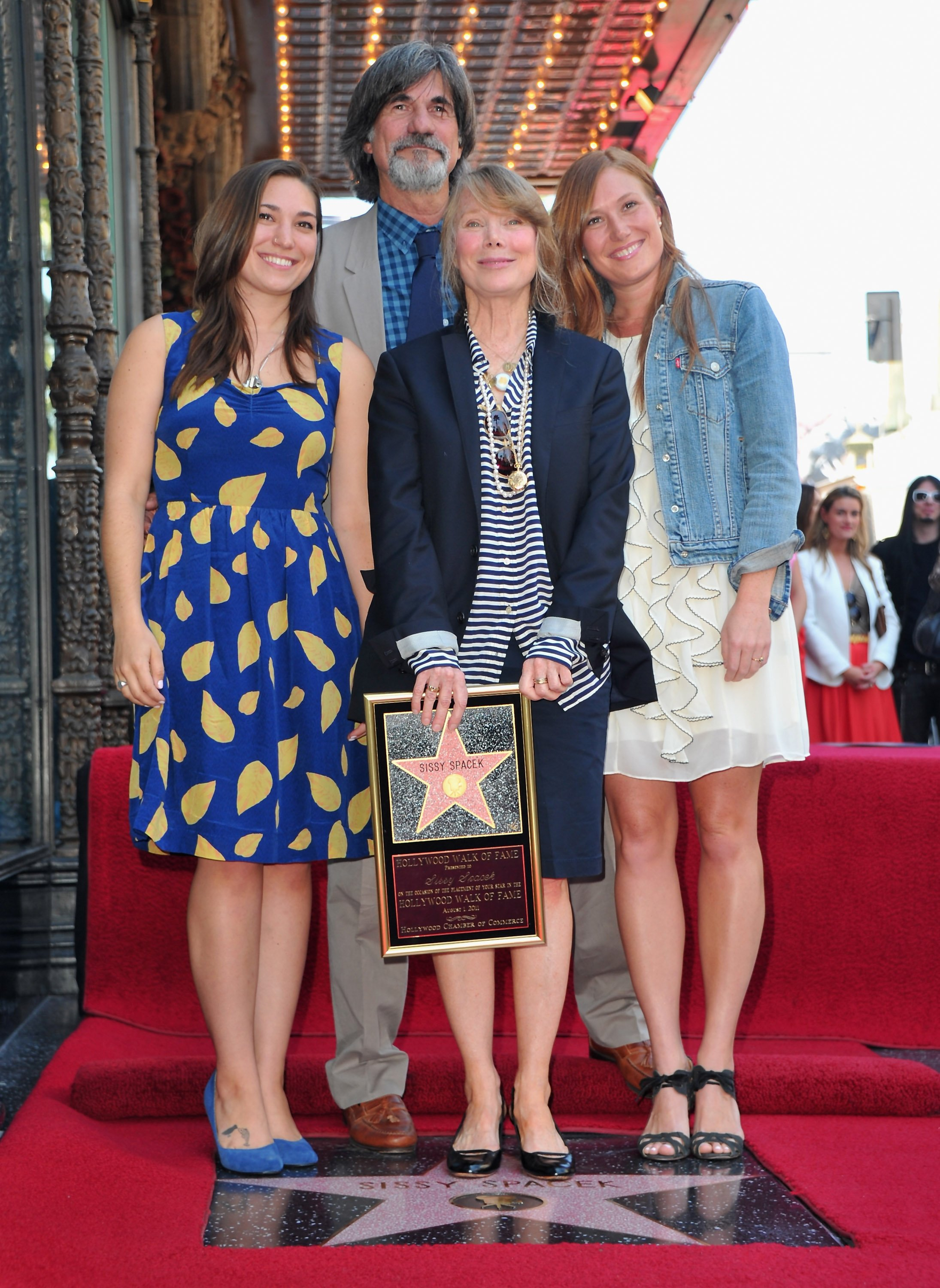 Madison Fisk, production designer Jack Fisk, actress Sissy Spacek and actress Schuyler Fisk attend the ceremony Honoring Sissy Spacek with the 2,443rd star on the Hollywood Walk of Fame in front of the El Capitan Theatre on August 1, 2011, in Hollywood, California. | Source: Getty Images.
