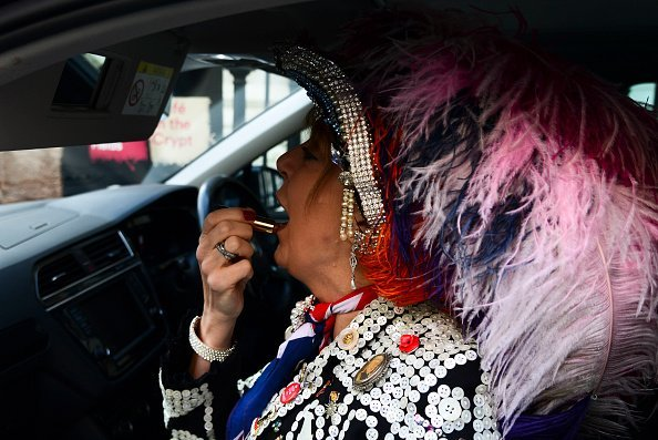A pearly Queen applies her lipstick ahead of a church service at St Martin-in-the-Fields church I Photo: Getty Images