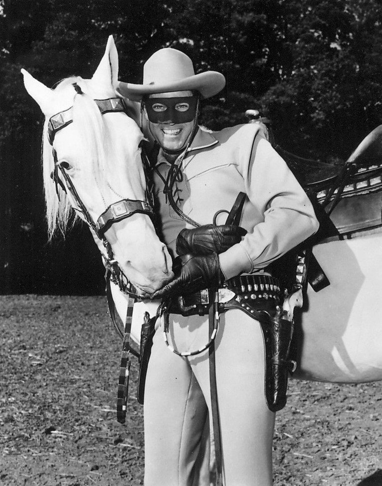 """Clayton Moore as the """"Lone Ranger"""" with his horse Silver in 1957.   Source: Wikimedia Commons."""