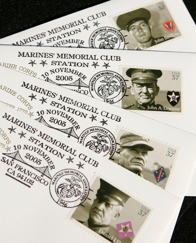 """New """"Distinguished Marines"""" commemorative stamps are seen on envelopes during the unveiling ceremony for the new stamp on November 10, 2005 in San Francisco   Source: Getty Images"""