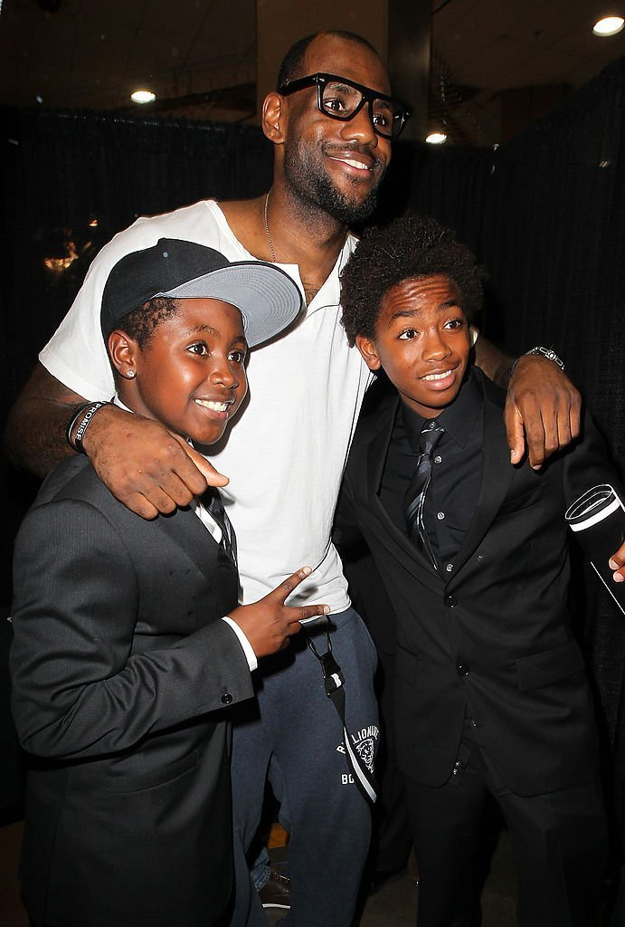 LeBron James (center) with Anderson Silva's children during UFC 148 inside MGM Grand Garden Arena | Getty Images
