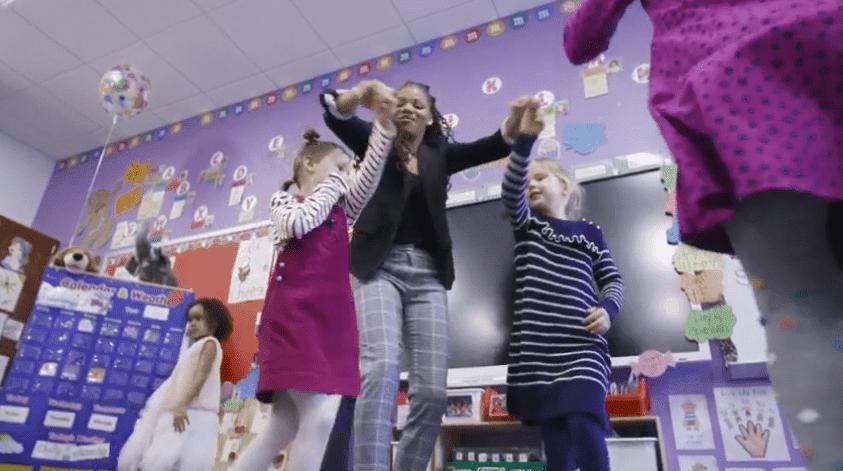 Lakeisha Brown, winner of the Washington DC's Teacher of the Year award and her students.  Photo: YouTube/ DC EdFund.